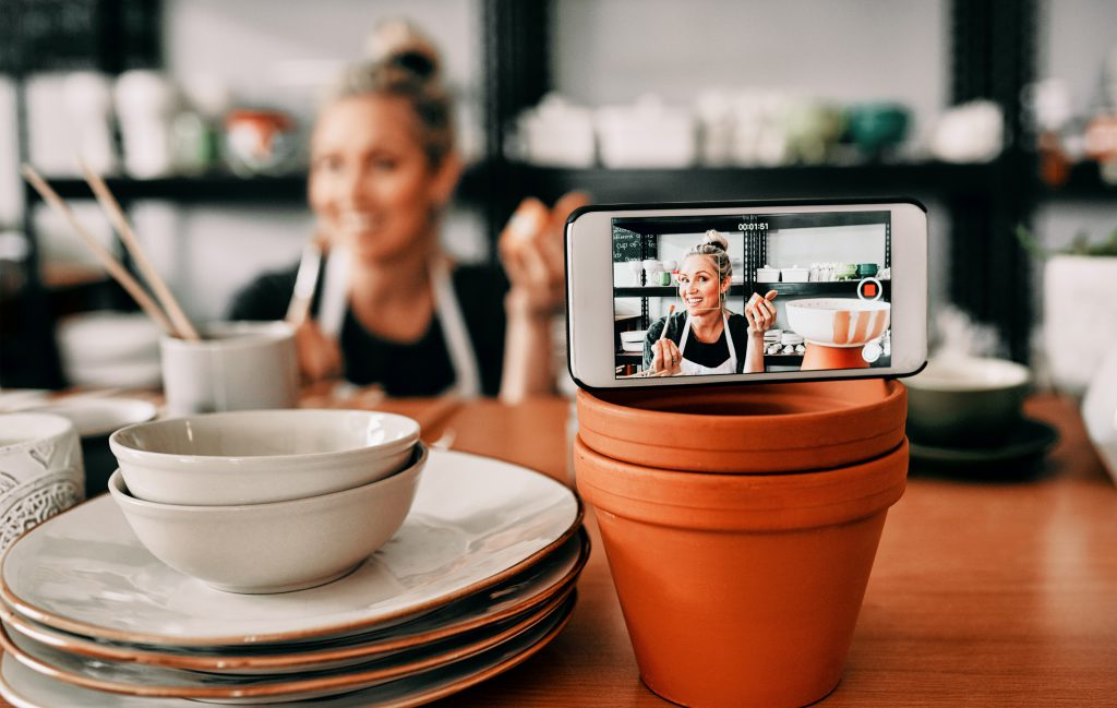 Small business owner recording herself for social media