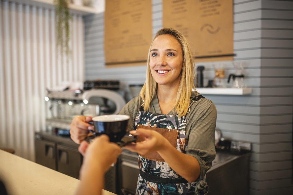 Serving coffee to customer