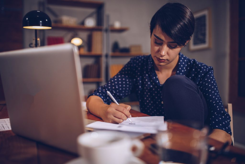 Woman intently working on invoicing