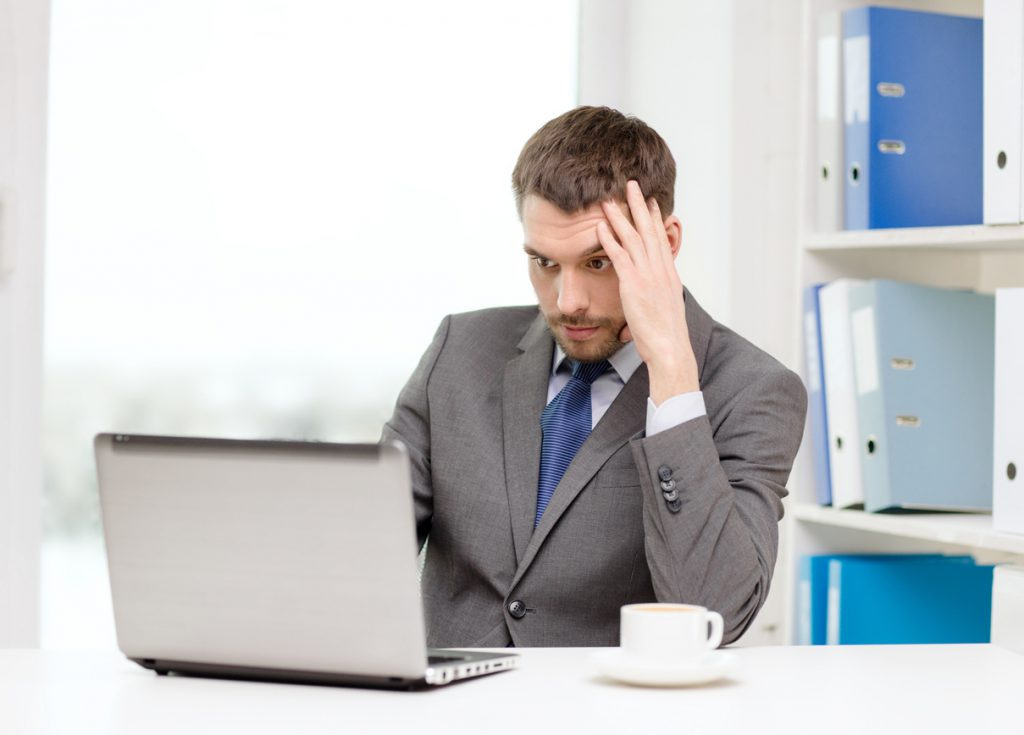 Busy businessman on computer at a desk