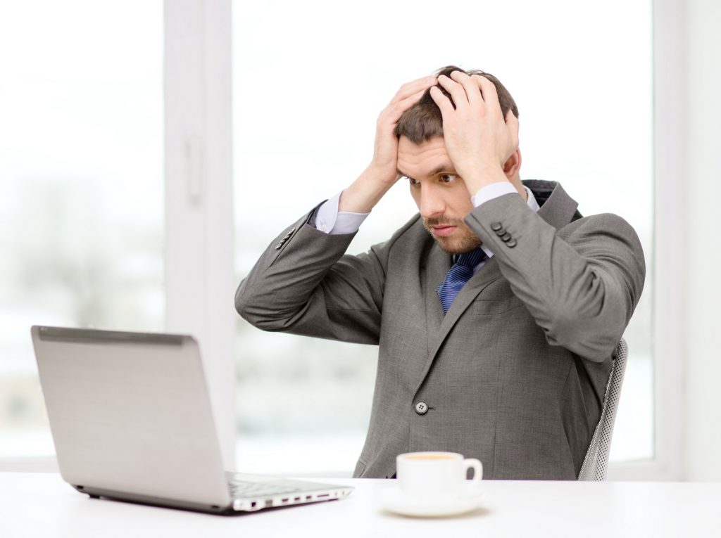 Businessman frustrated with payroll